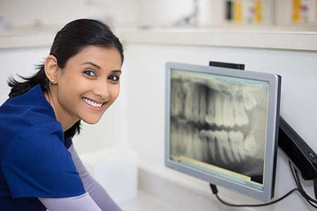 Dentist Looking At Oral Scan Resources